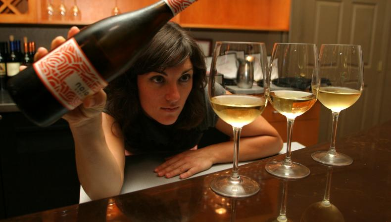 Image of a woman pouring wine at the Wine Loft at slate street cafe